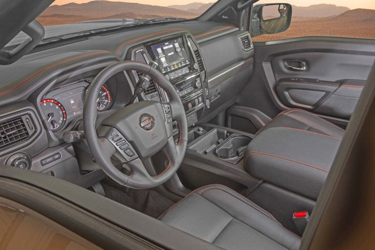 Black with red stitching interior of Nissan Titan