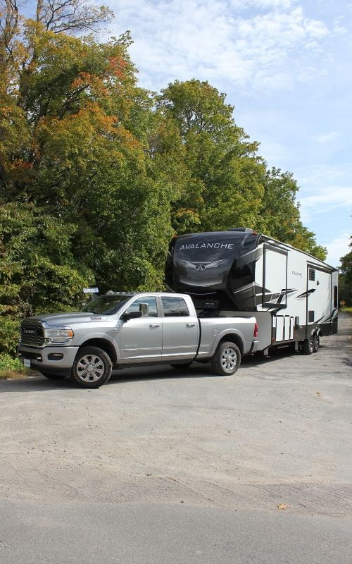 Silver truck towing trailer