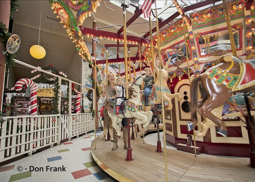 Carousel with mother and child riding