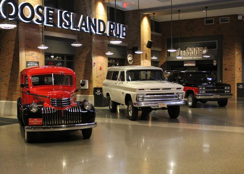 Three classic Suburbans on display.