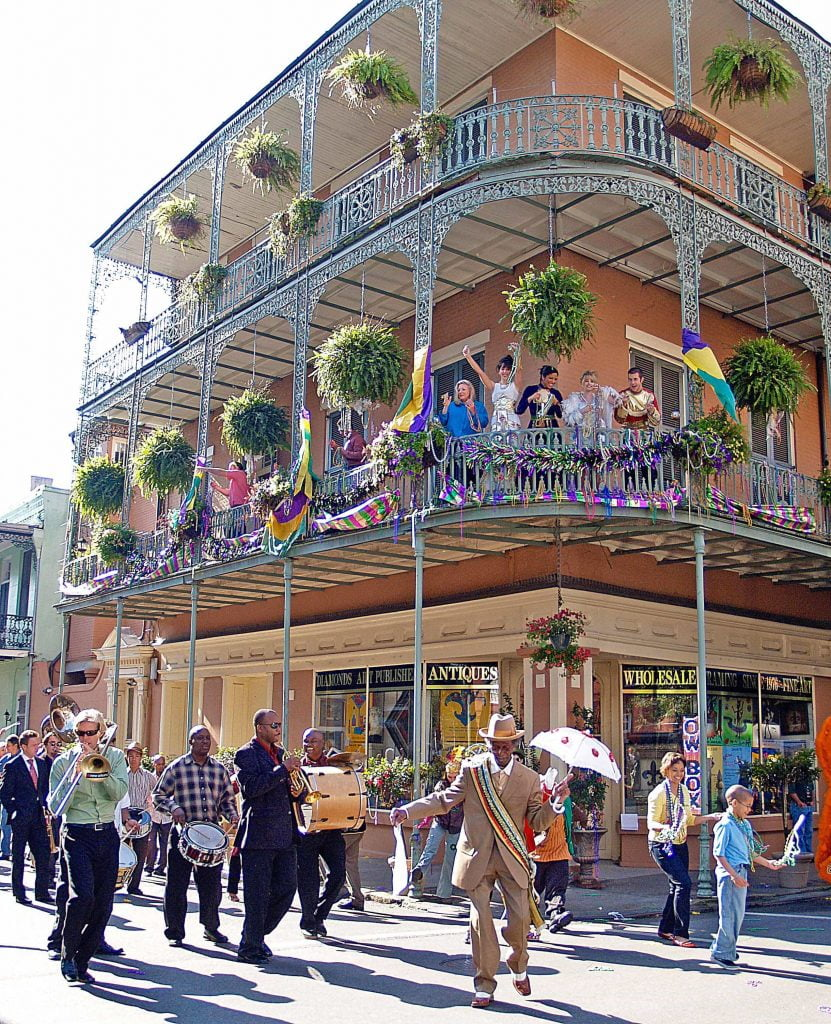 Street parades are a common sight in the French Quarter. Revellers often join in from the balconies. Below: Music is found in small venues and on most street corners, especially in the French Quarter of New Orleans.