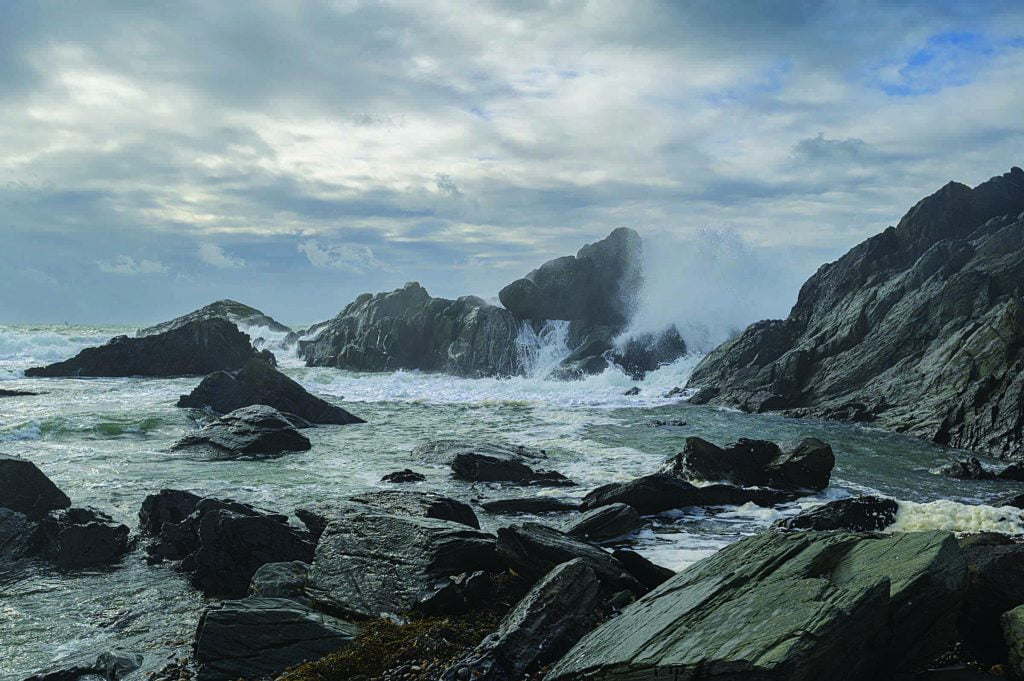 Winds driving waves over 30-40 foot rocks and cliffs at Cape Forchu, NS