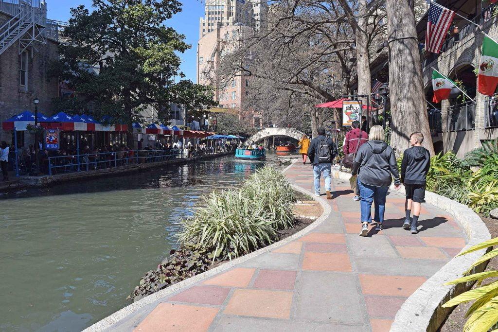 People walking along the riverside