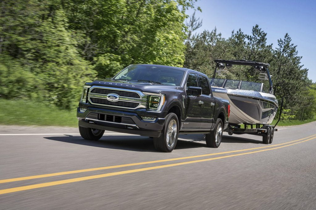 Ford truck pulling boat