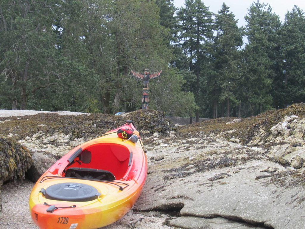 Kayak and Totem pole