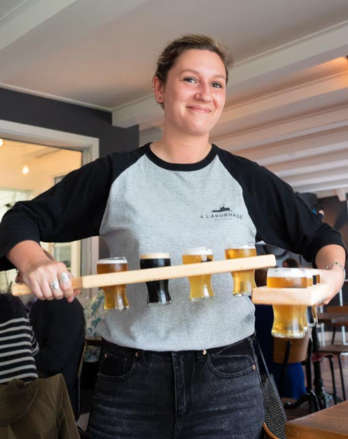 Waitress with a beer flight