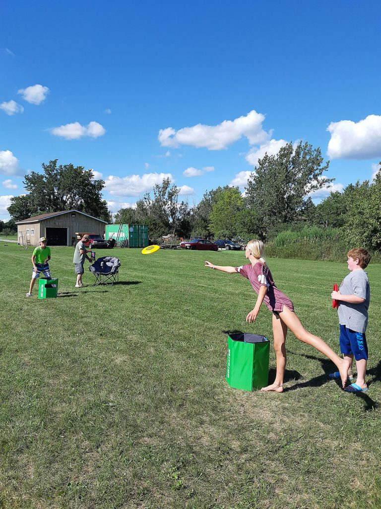 Kids playing outdoor games in a field