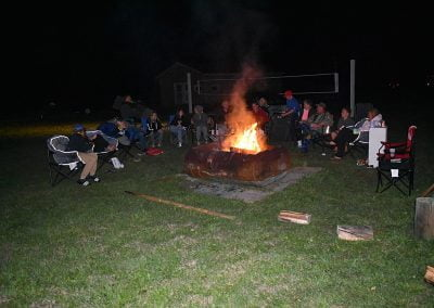 Large family sitting around the campfire