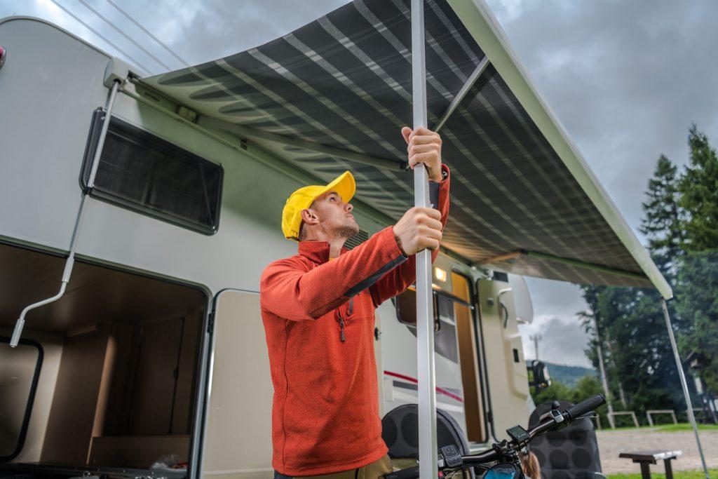 Man setting up trailer awning
