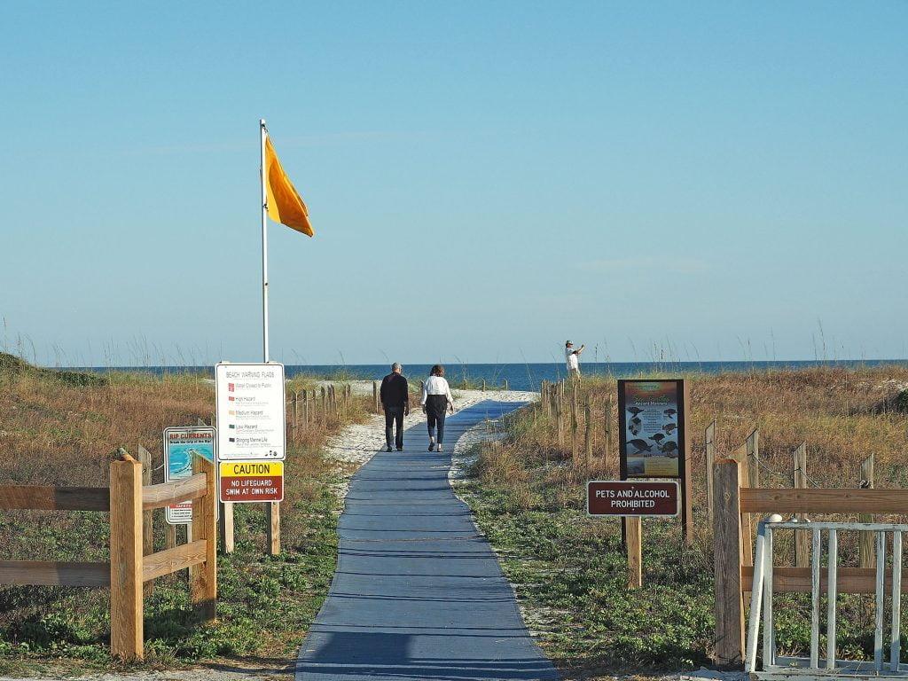 Couple walking along a boardwalk