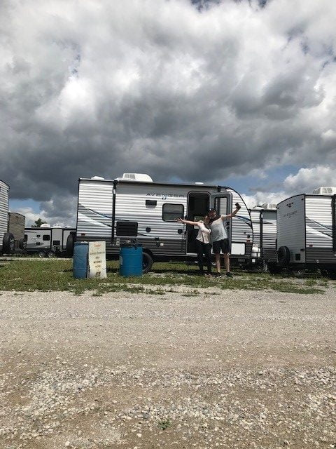 Couple standing in front of trailer