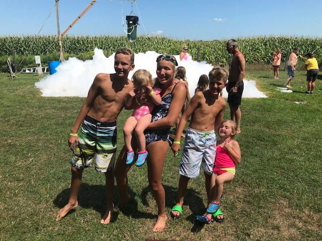 kids playing at a foam party
