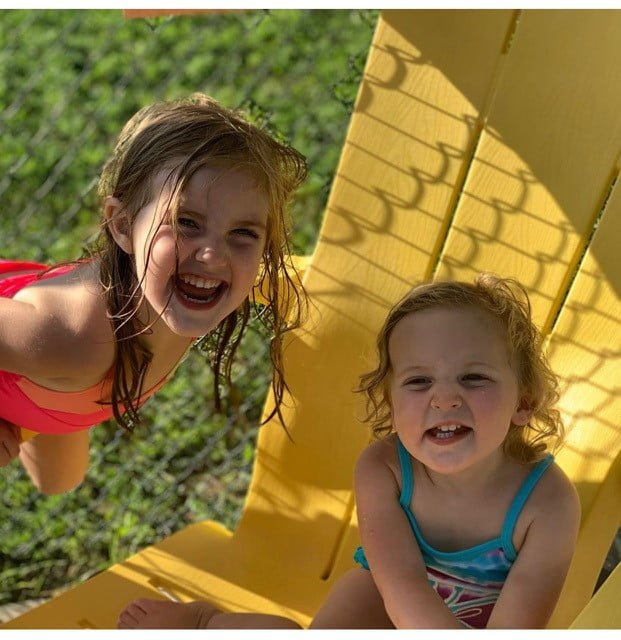 two little girls on a chair