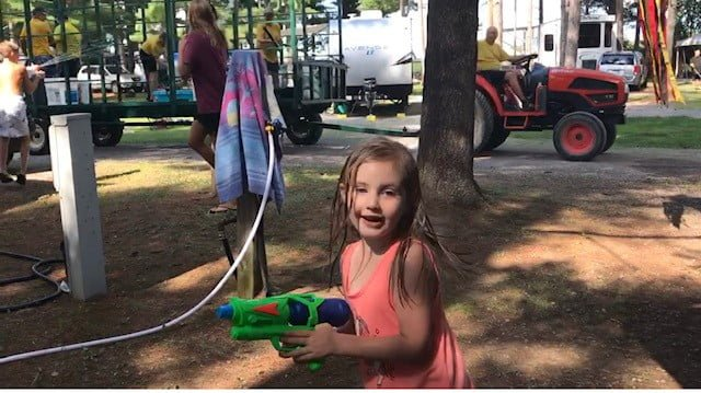 kids in a water gun fight