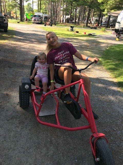 kids riding a double bike