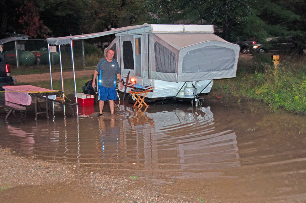 An eroded campsite bowl, flooding after a thunderstorm