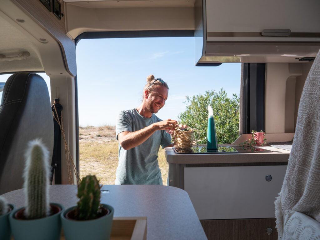 Man looks after cactuses in his van