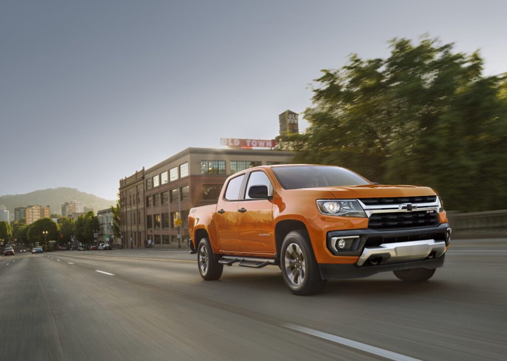 orange chevrolet colorado pickup truck