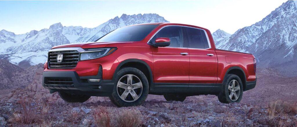 Side view of a red 2021 Honda Ridgeline pickup truck