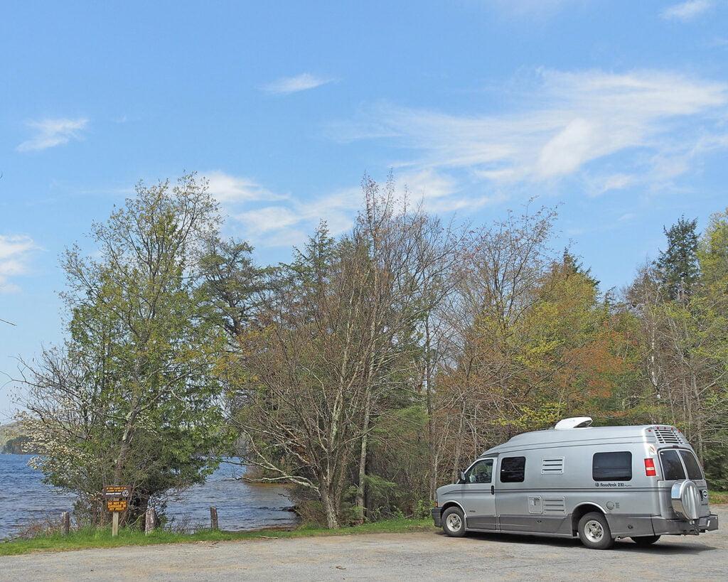 RV parked near water