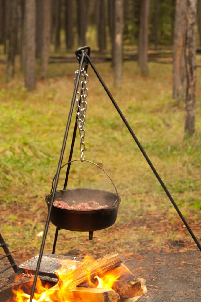 Dutch oven cooking on a tripod over a fire