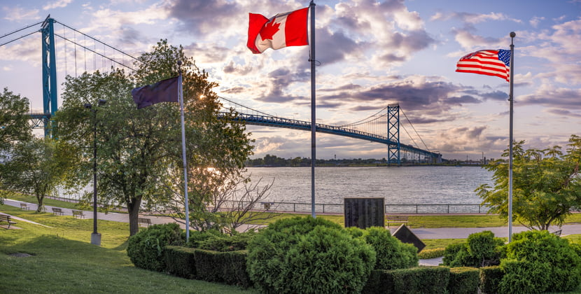 The Ambassador bridge links Detroit, Michigan with Windsor, Ontario. It is one of the busiest trade routes in North America. This photo was taken from Windsor, Ontario, Canada, facing North-West towards Detroit.