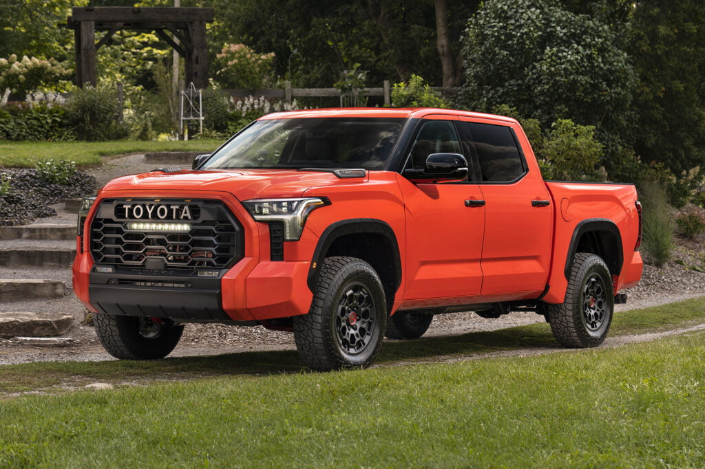 Side exterior view of the new 2022 Toyota Tundra in red