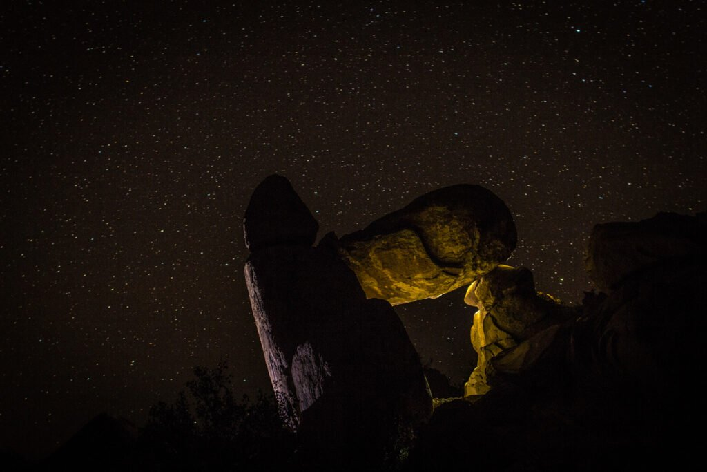 A balanced rock at night in Big Bend National Park.