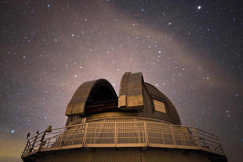 The Mont-Mégantic Dark Sky Preserve, a popular celestial tourism site, with its observatory roof doors sliding open.